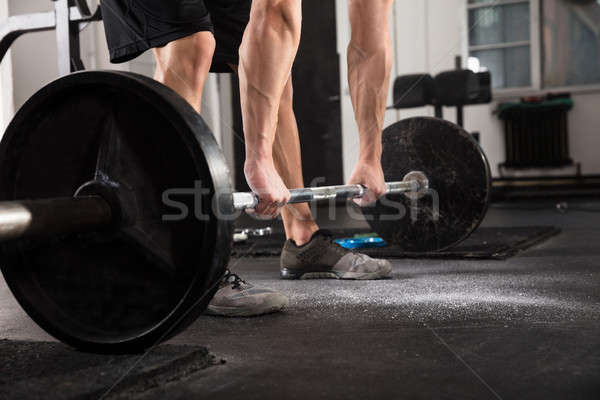 Fitness Man With Weights Doing Exercises Stock photo © AndreyPopov