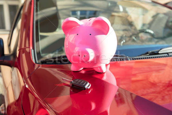 Piggybank With Car Key On Car Stock photo © AndreyPopov