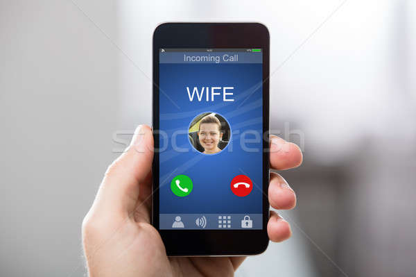 Person Receiving Wife's Incoming Call Stock photo © AndreyPopov