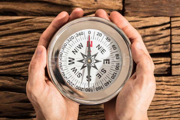 Hand Holding Compass Stock photo © AndreyPopov