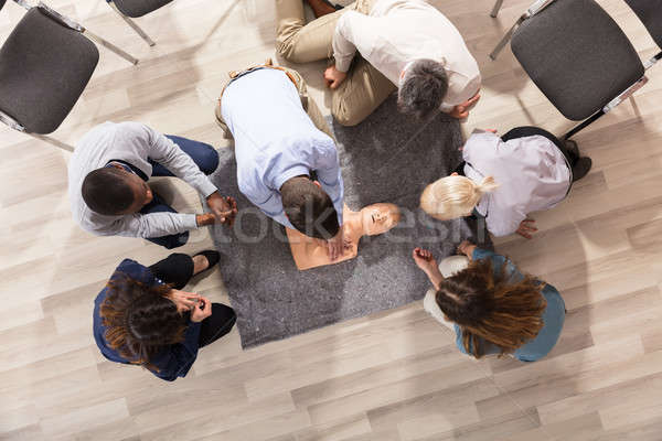 Stock photo: First Aid Instructor Demonstrating CPR Training On Dummy