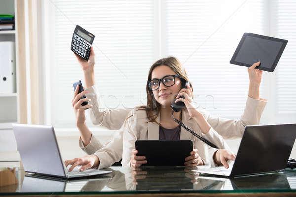 Multitarefa empresária escritório ocupado jovem sorridente Foto stock © AndreyPopov
