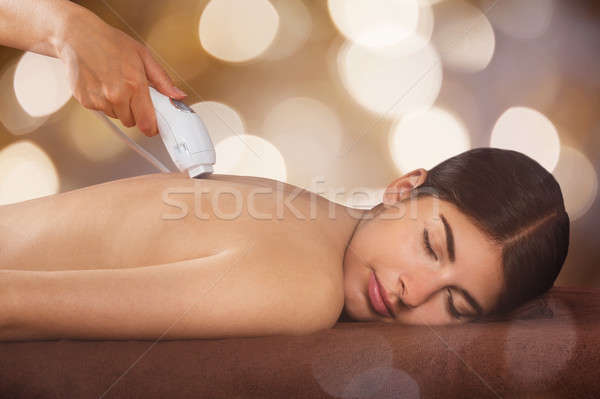 Woman Receiving Epilation Laser Treatment On Back Stock photo © AndreyPopov