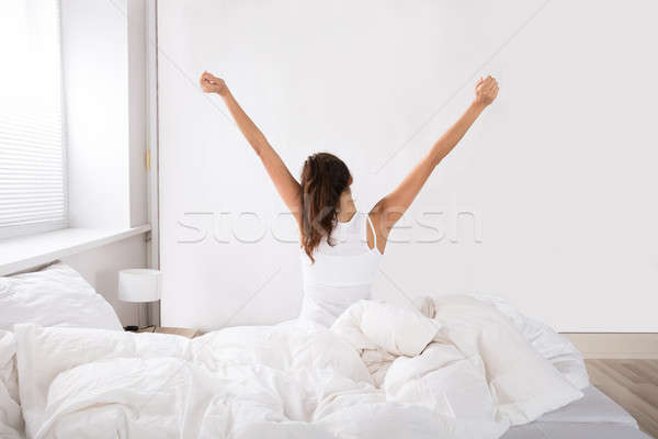 Rear View Of A Woman Wake Up Stock photo © AndreyPopov