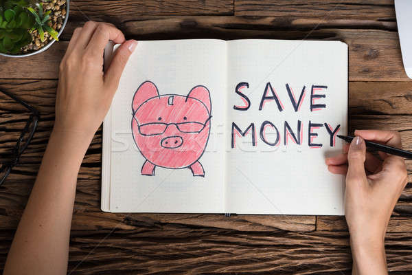 Businessperson Drawing Save Money Concept Stock photo © AndreyPopov