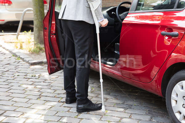 Stock photo: Disabled Person Standing Near Car