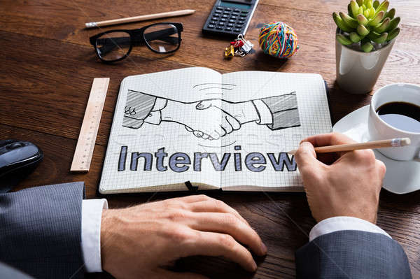 Human Hand Drawing Interview Concept Stock photo © AndreyPopov