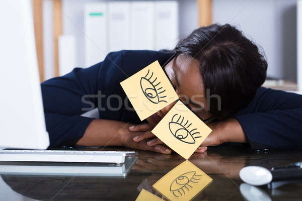 Woman Sleeping With Eyes Drawn On Adhesive Notes Stock photo © AndreyPopov