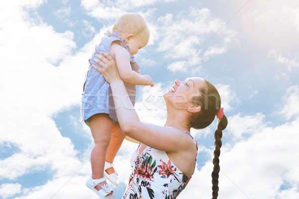 Happy Woman Carrying Baby Stock photo © AndreyPopov