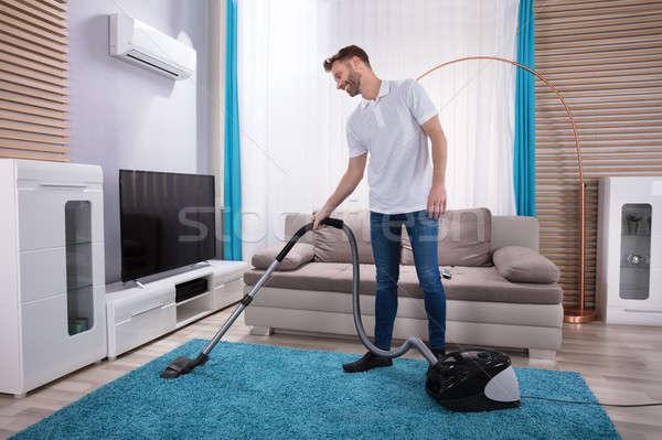 человека очистки ковер пылесос молодым человеком синий Сток-фото © AndreyPopov