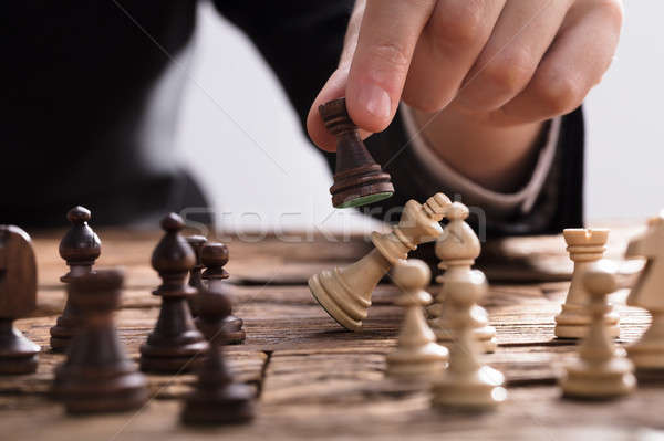 Businessperson Checkmating King Chess Piece With Rook Stock photo © AndreyPopov