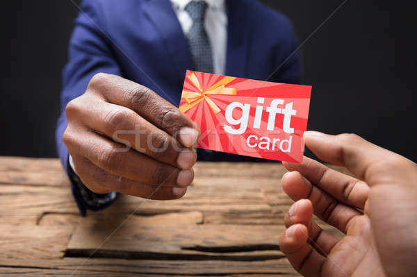 Businessman Giving Gift Card To His Partner Stock photo © AndreyPopov
