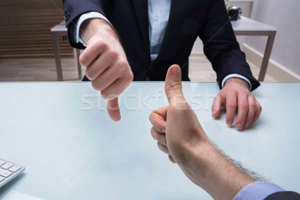 Hands Showing Thumb Up And Thumb Down Sign Stock photo © AndreyPopov