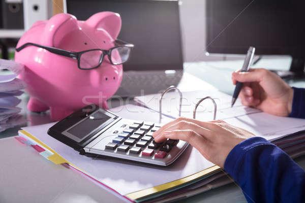 Businessperson Calculating Bill With Calculator Stock photo © AndreyPopov