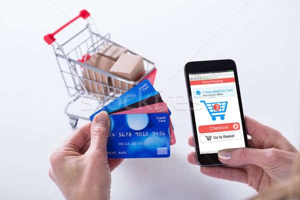 Kişi alışveriş çevrimiçi kredi kartları cep telefonu Stok fotoğraf © AndreyPopov