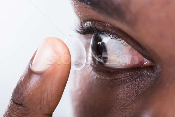 Person Putting Contact Lens In Eye Stock photo © AndreyPopov