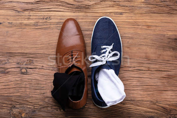 Elevated View Of Male's Formal And Sport Shoe Stock photo © AndreyPopov
