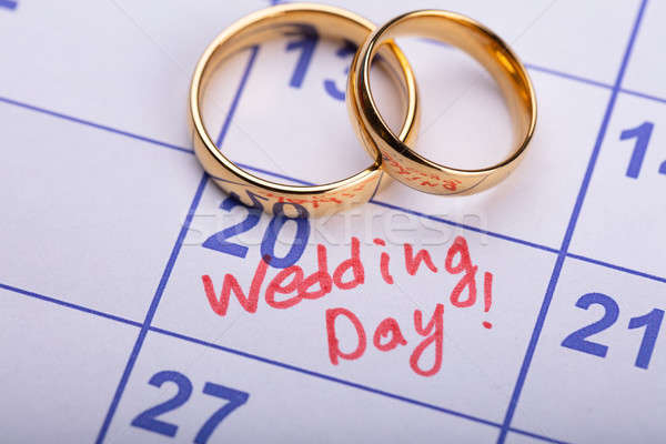 Two Wedding Rings On Calendar Stock photo © AndreyPopov