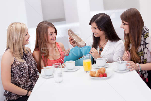 Women discussing footwear together Stock photo © AndreyPopov