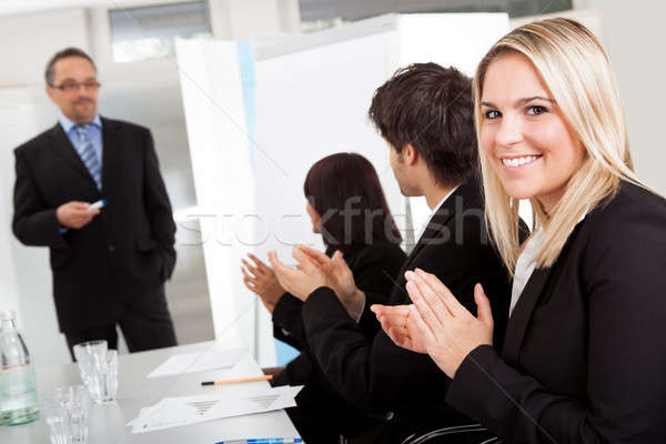 Businesswoman at presentation applauding Stock photo © AndreyPopov