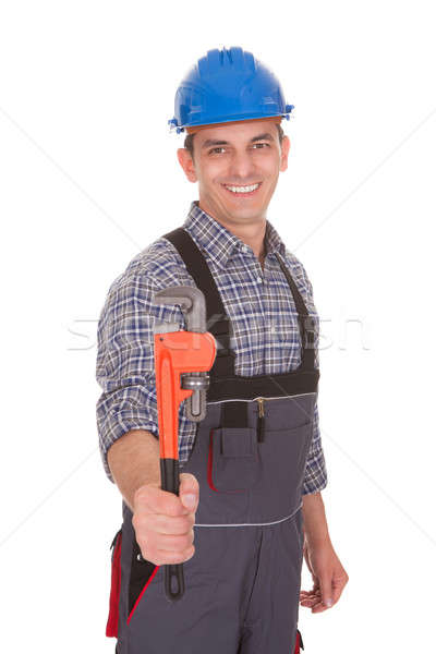 Portrait Of A Male Worker Holding Worktool Stock photo © AndreyPopov