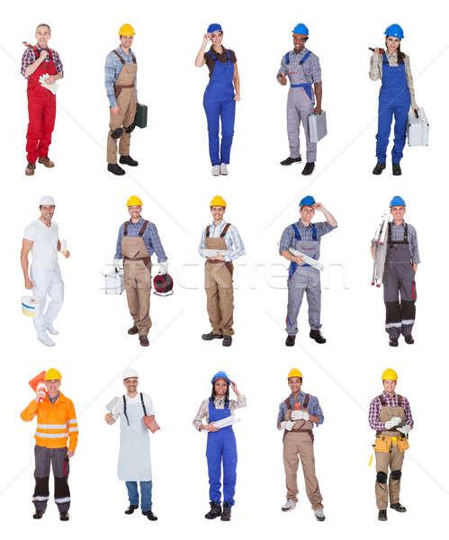 Groupe construction travailleurs permanent blanche sourire Photo stock © AndreyPopov