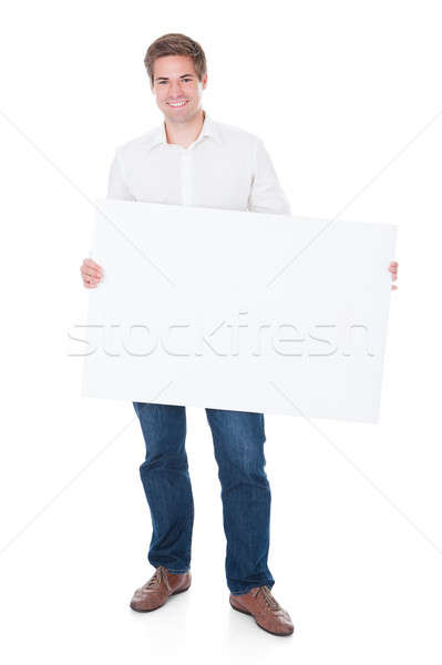 Man Holding Blank Placard Stock photo © AndreyPopov