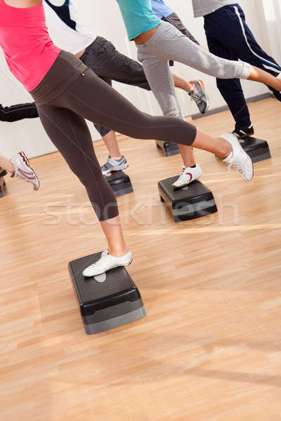 Class doing aerobics balancing on boards Stock photo © AndreyPopov