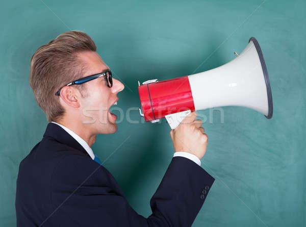 Mannelijke hoogleraar megafoon schoolbord business Stockfoto © AndreyPopov