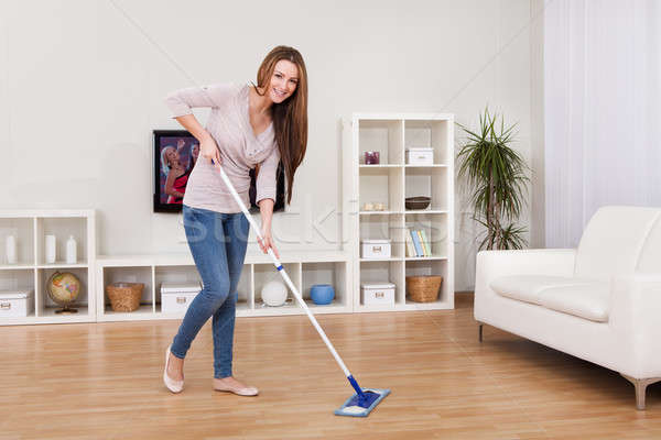 Young Woman Cleaning Floor Stock photo © AndreyPopov