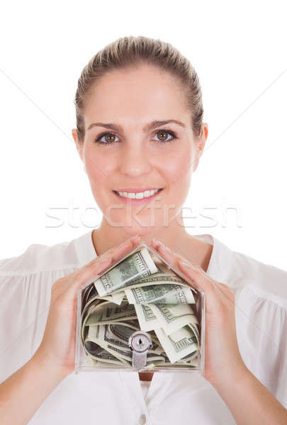 Young Woman Holding A Box Of Currency Stock photo © AndreyPopov