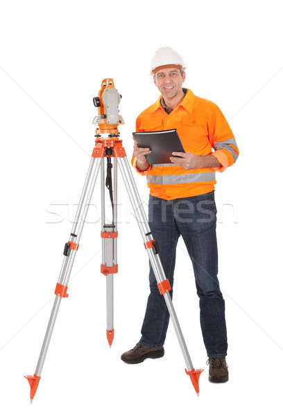 Stock photo: Senior land surveyor with theodolite
