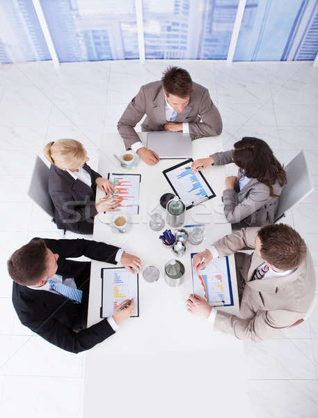 Business People Discussing On Graphs At Conference Table Stock photo © AndreyPopov