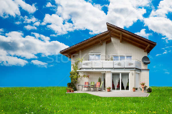 Exterior Of House On Grassy Landscape Stock photo © AndreyPopov