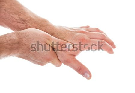 Person Pressing Palm With Thumb Stock photo © AndreyPopov