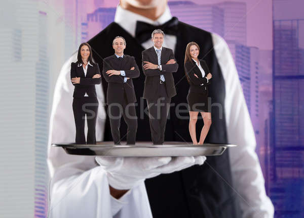 Gens d'affaires argent plateau réalisée garçon permanent Photo stock © AndreyPopov