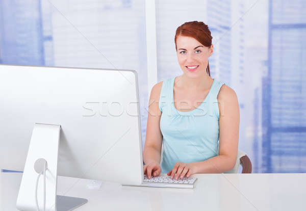 Businesswoman Using Computer In Office Stock photo © AndreyPopov