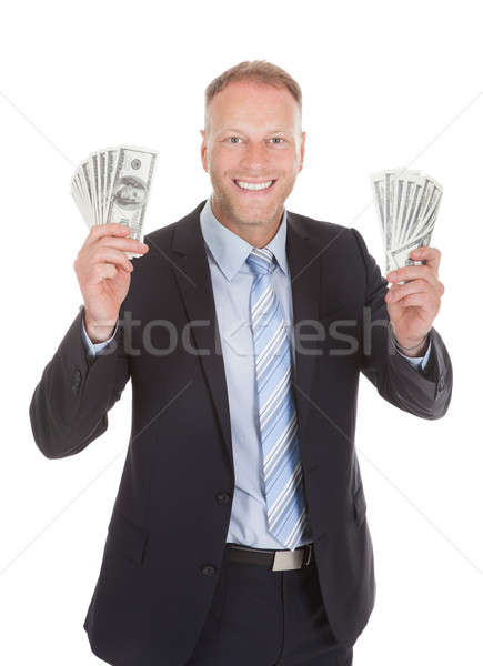 Smiling Businessman Holding Bank Notes Stock photo © AndreyPopov