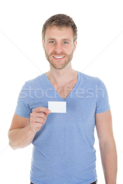 Confident Man Holding Visiting Card Stock photo © AndreyPopov