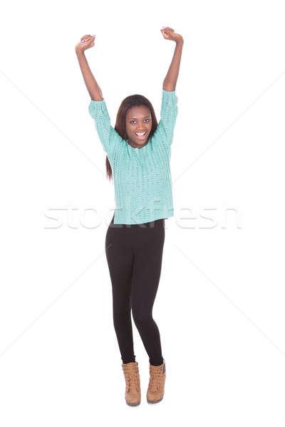 Izgatott fiatal nő karok a magasban teljes alakos portré áll Stock fotó © AndreyPopov