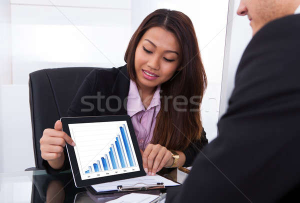 Businesswoman Showing Digital Tablet To Colleague Stock photo © AndreyPopov