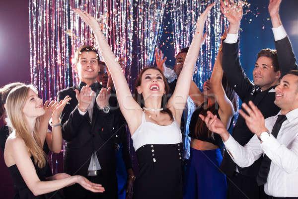 Friends Celebrating In Nightclub Stock photo © AndreyPopov