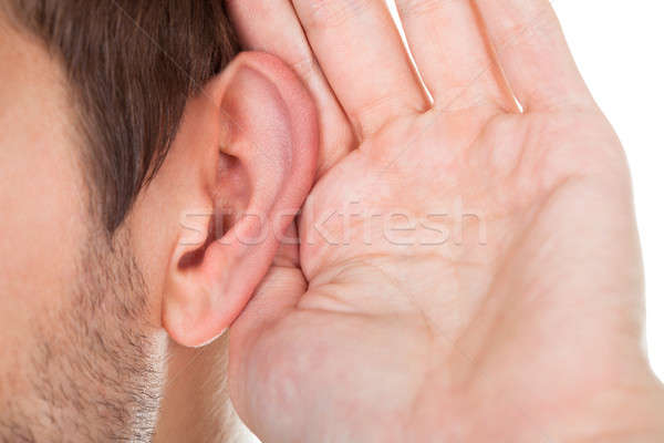 Close-up Of Hand Near Ear Stock photo © AndreyPopov