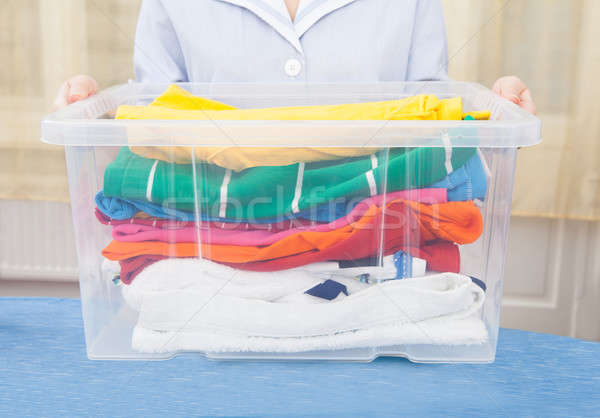 Maid Holding Laundry Basket Stock photo © AndreyPopov