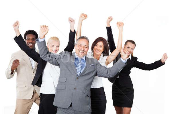 Sikeres üzleti csapat karok a magasban fehér portré áll Stock fotó © AndreyPopov