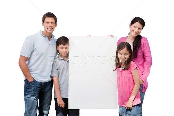 Ritratto famiglia felice cartellone isolato bianco Foto d'archivio © AndreyPopov