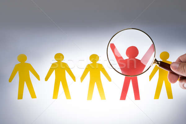 Hand Magnifying Red Paperman Representing Recruitment Stock photo © AndreyPopov