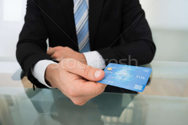 Midsection Of Businessman Giving Credit Card Stock photo © AndreyPopov