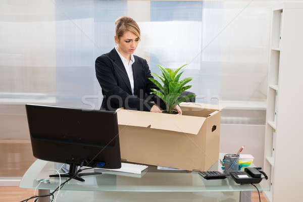Businesswoman Packing Belongings In Box Stock photo © AndreyPopov