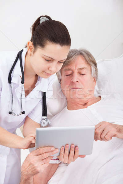 Stock photo: Doctor And Patient Looking At Digital Tablet